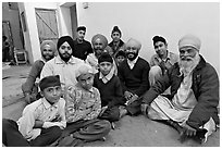 Sikh men and boys in gurdwara. Bharatpur, Rajasthan, India (black and white)