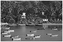 Boats, and palm-tree covered hillside, Dona Paula. Goa, India ( black and white)