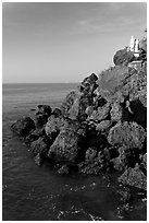 Boulders and christian statues overlooking ocean, Dona Paula. Goa, India (black and white)