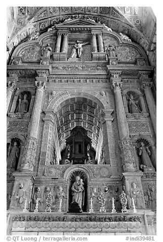 Gilded and carved woodwork, Church of St Francis of Assisi altar, Old Goa. Goa, India (black and white)