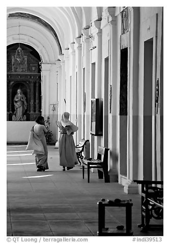 Woman and nun in Convent of St Monica , Old Goa. Goa, India (black and white)