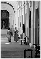 Woman and nun in Convent of St Monica , Old Goa. Goa, India ( black and white)