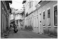 Street with painted houses, Panaji. Goa, India (black and white)