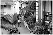 Man in alley with gardens, Panjim. Goa, India ( black and white)
