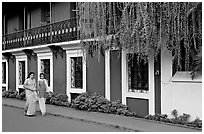 Women strolling past the heritage Panaji Inn, Panjim. Goa, India ( black and white)