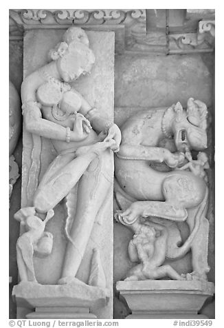 Sculpture of woman removing thorn from foot, Parsvanatha temple, Eastern Group. Khajuraho, Madhya Pradesh, India (black and white)