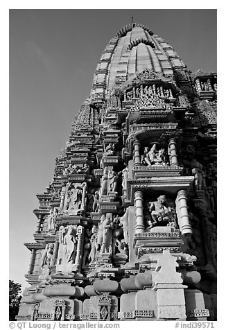 Bands of carved sculptures below spire (sikhara), Javari Temple, Eastern Group. Khajuraho, Madhya Pradesh, India (black and white)