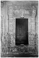 Inner sanctum with flowers and Vishnu image, Javari Temple, Eastern Group. Khajuraho, Madhya Pradesh, India (black and white)