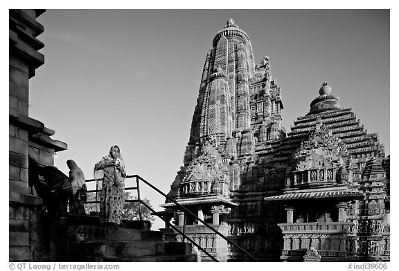 Woman with offering pot in front of Lakshmana temple. Khajuraho, Madhya Pradesh, India (black and white)