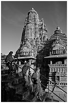 Women going down stairs in front of Lakshmana temple. Khajuraho, Madhya Pradesh, India (black and white)