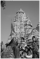 Morning Puja in front of Lakshmana temple. Khajuraho, Madhya Pradesh, India (black and white)