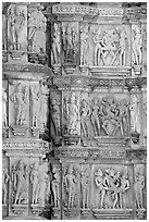 Carvings on the outside of Kadariya-Mahadeva temple including erotic figures. Khajuraho, Madhya Pradesh, India (black and white)