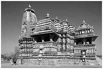 Devi Jagadamba temple with women walking. Khajuraho, Madhya Pradesh, India (black and white)