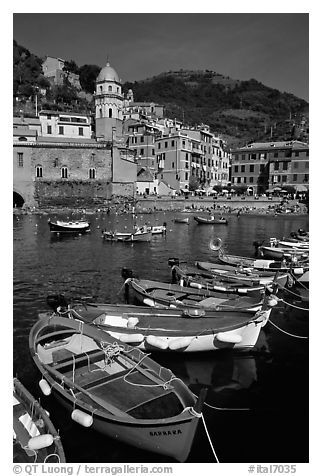 Colorful samll fishing boats in the harbor and main plaza, Vernazza. Cinque Terre, Liguria, Italy (black and white)