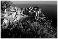 Harbor, church, 11th century castle and village, late afternoon, Vernazza. Cinque Terre, Liguria, Italy ( black and white)