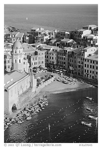 Church, harbor, and beach seen from above, Vernazza. Cinque Terre, Liguria, Italy (black and white)