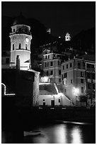 Churches illuminated at night, Vernazza. Cinque Terre, Liguria, Italy (black and white)