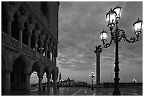 Lamp, column with Lion, Piazza San Marco (Square Saint Mark) at dawn. Venice, Veneto, Italy (black and white)