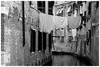 Clothelines and canal in a popular quarter, Castello. Venice, Veneto, Italy (black and white)