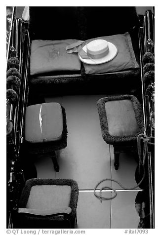Empty gondola with seats and gondolier's hat. Venice, Veneto, Italy (black and white)