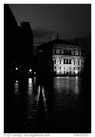 Rezzonico palace illuminated at night, along the Grand Canal. Venice, Veneto, Italy (black and white)