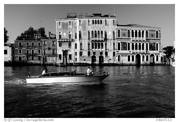 Water taxi passes in front of the Palazzo Dorio on the Grand Canal. Venice, Veneto, Italy (black and white)
