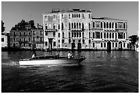 Water taxi passes in front of the Palazzo Dorio on the Grand Canal. Venice, Veneto, Italy ( black and white)