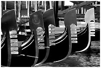 Row of gondolas prows, with their characteristic ferri. Venice, Veneto, Italy (black and white)