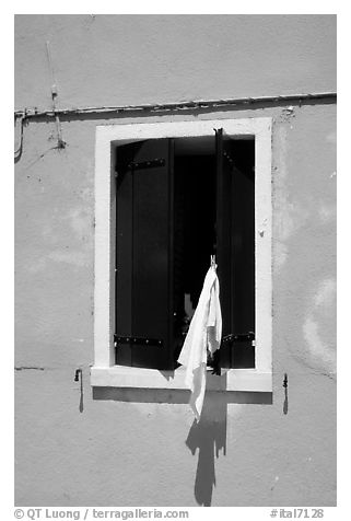 Laundry hanging from a window, Burano. Venice, Veneto, Italy (black and white)