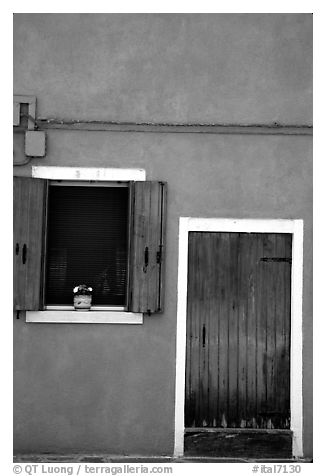 Door, window, pink-colored house,  Burano. Venice, Veneto, Italy (black and white)