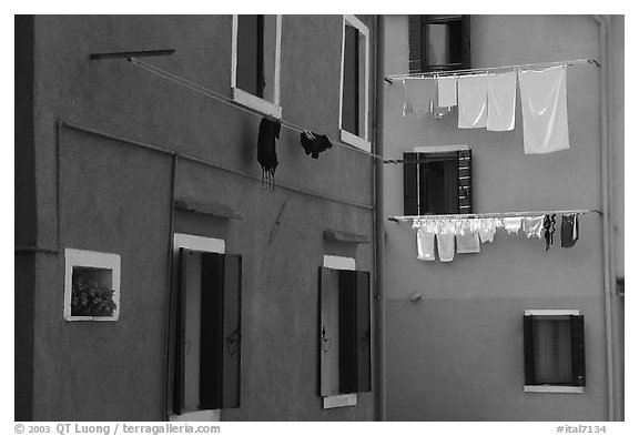 Multicolored houses and hanging laundry, Burano. Venice, Veneto, Italy (black and white)
