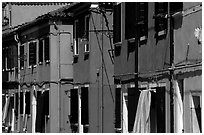 Facades of brightly painted houses, Burano. Venice, Veneto, Italy (black and white)