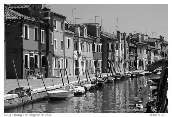 Canal lined with typical brightly painted houses, Burano. Venice, Veneto, Italy (black and white)