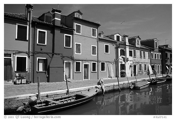 Canal bordered by colorfully painted houses, Burano. Venice, Veneto, Italy (black and white)
