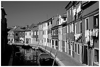 Canal lined with multihued houses, Burano. Venice, Veneto, Italy (black and white)