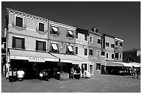 Street with brightly painted houses, Burano. Venice, Veneto, Italy ( black and white)