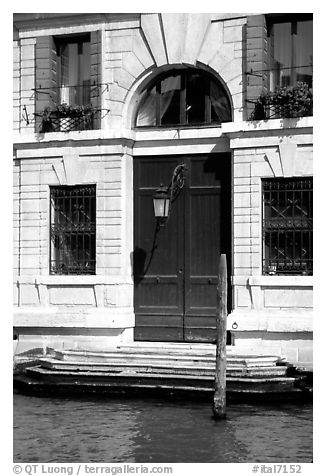 Doorway and steps on the Grand Canal. Venice, Veneto, Italy (black and white)