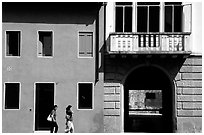 House facades with women walking. Veneto, Italy ( black and white)