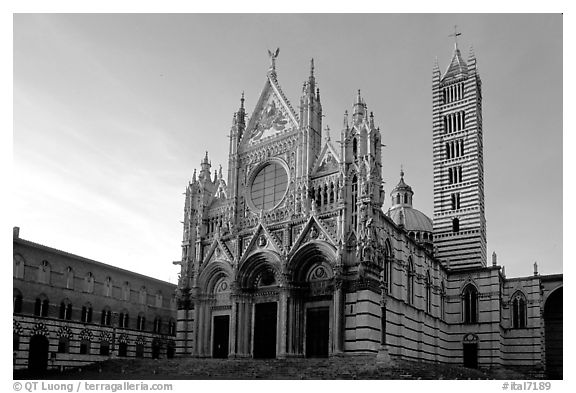Siena Cathedral (Duomo) with bands of colored marble, late afternoon. Siena, Tuscany, Italy (black and white)