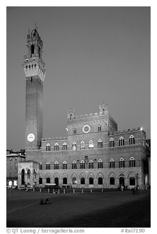 Piazza Del Campo and Palazzo Pubblico at dusk. Siena, Tuscany, Italy (black and white)