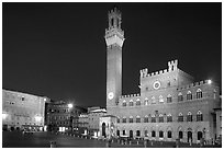 Piazza Del Campo and Palazzo Pubblico at night. Siena, Tuscany, Italy (black and white)