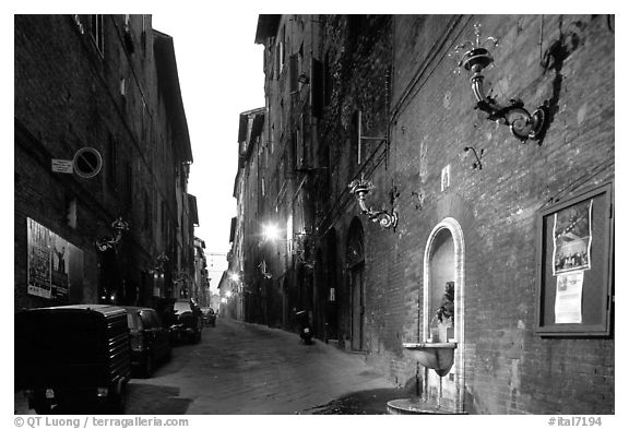 Street and fountain at dawn. Siena, Tuscany, Italy (black and white)