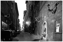 Street and fountain at dawn. Siena, Tuscany, Italy ( black and white)