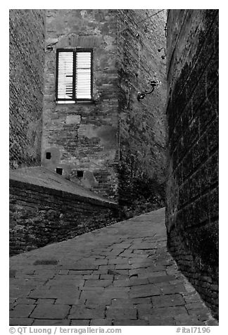 Street and window at dawn. Siena, Tuscany, Italy (black and white)