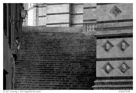Woman cleaning up besides the Duomo stairs. Siena, Tuscany, Italy (black and white)