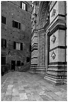 Small square besides the Duomo. Siena, Tuscany, Italy ( black and white)