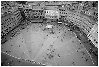 Medieval Piazza Del Campo with paving divided into nine sectors to represent Council of Nine.. Siena, Tuscany, Italy (black and white)