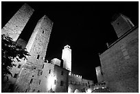 Medieval towers above Piazza del Duomo at night. San Gimignano, Tuscany, Italy (black and white)