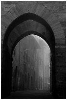 Arch at dawn in the fog. San Gimignano, Tuscany, Italy (black and white)