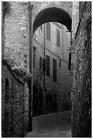 Arch and narrow street. San Gimignano, Tuscany, Italy (black and white)
